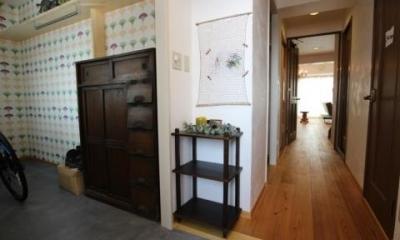 玄関土間|生活スタイルに合わせたリノベーションの姿(レトロなカフェ風空間でくつろぐ住まい)