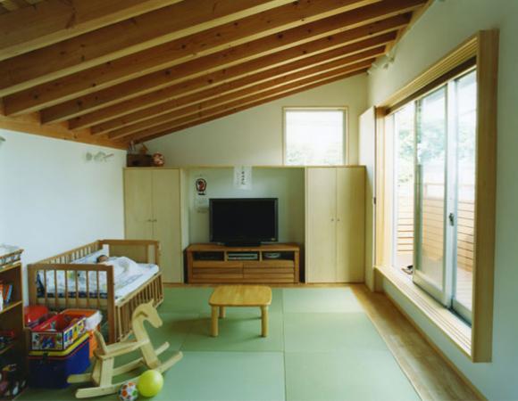 大塚新町の家の写真 縁無し畳のあるリビング