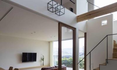 生駒の家 (吹き抜けの土間のある玄関)