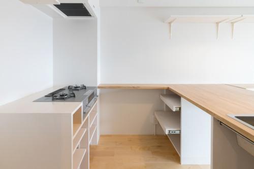 明大前のリノベーションの部屋 コの字型のキッチン