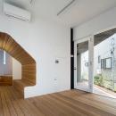 北千束の集合住宅の写真 ベンチのある洋室