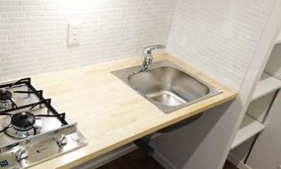 無垢材が優しく薫るスタイリッシュな空間 (キッチン)