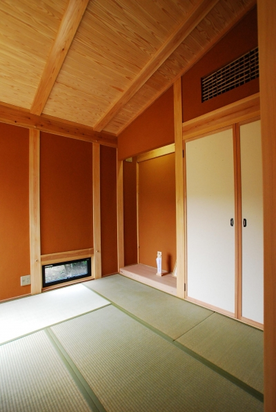 和室 (薪ストーブのある平屋建ての家)