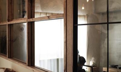 ガラス越しに望むショップのようなもうひとつの風景:マンションリノベーションK様邸