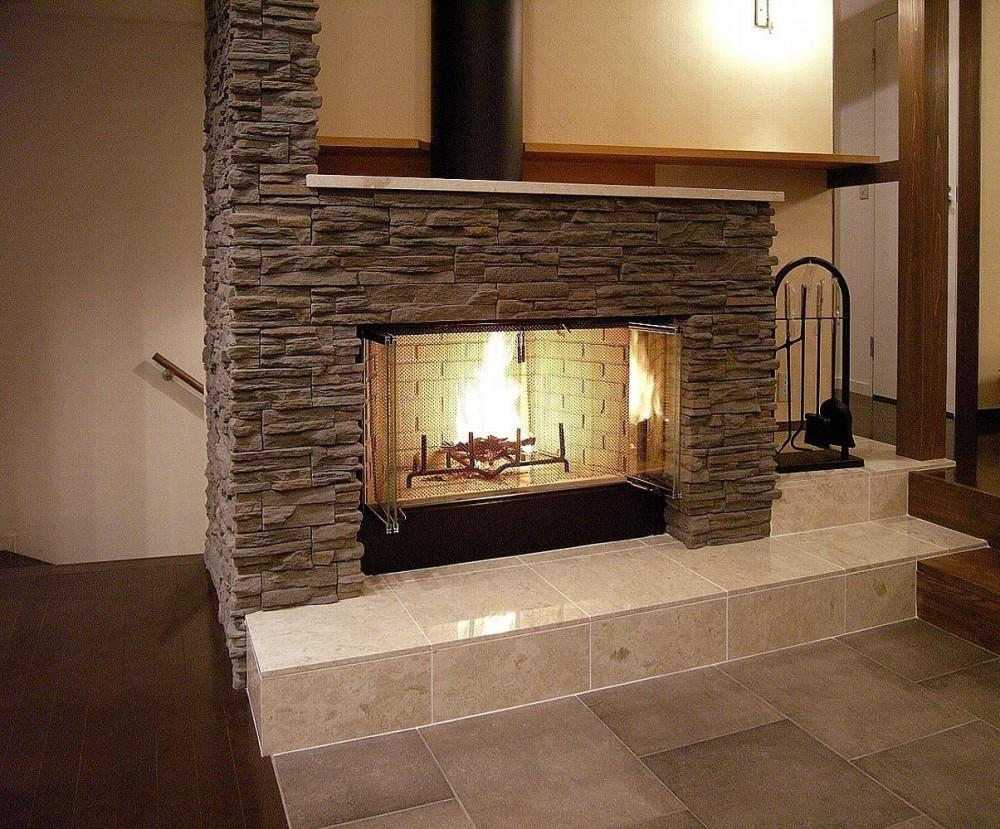 地下1階地上3階の混構造|バス通りの家 (暖炉)