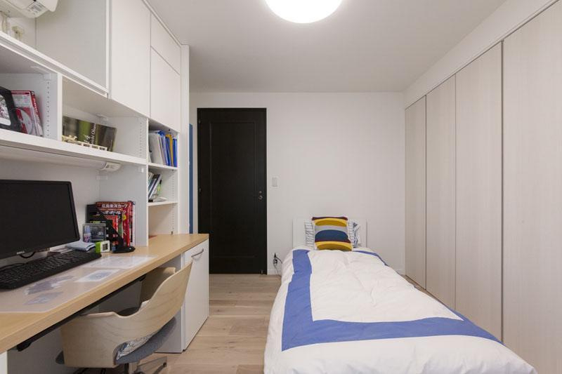 家族団欒と子どもの成長が楽しみな住まいの写真 寝室