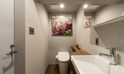 洗面室|石張り壁のあるフルリノベーション:『品川区五反田のリノベーション』