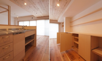 天井高さを抑えたキッチン・ダイニング空間|土間スペースと小上がり寝室・床下収納のある木の住まい
