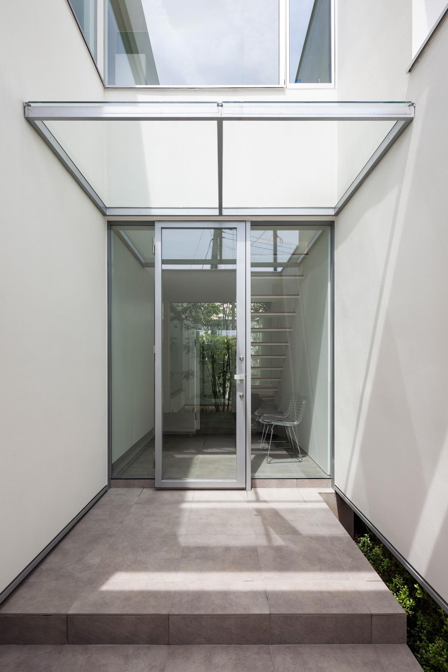 玄関事例:玄関ポーチ(立体市松壁の家)