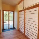 庭を囲むL型の家〜診療室付子建住宅の写真 診療室