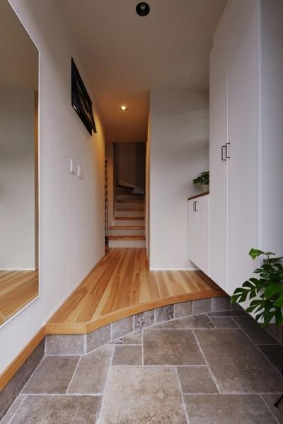 玄関 (キッチンからはじまる家族の時間 ~LDKを2階に移動し、勾配天井で広がりのある くつろぎ空間に~)