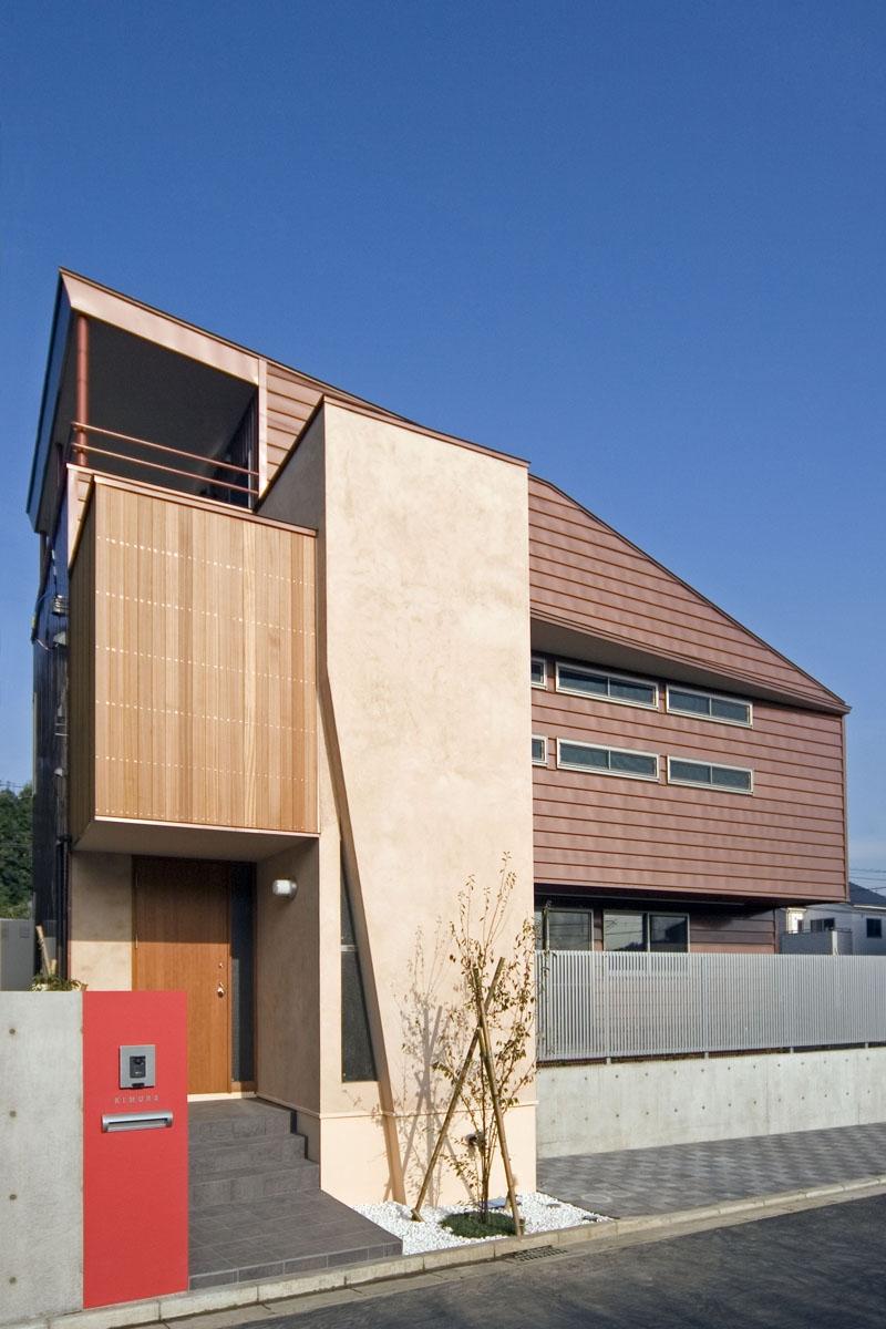 埼玉県和光市の区画整理地の家の写真 3つの茶系テクスチャーで構成された外観