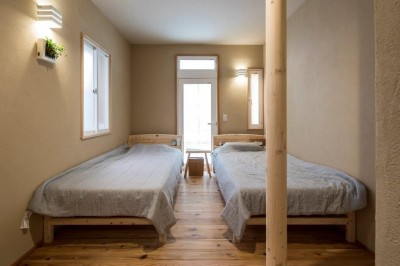 ベッドルーム (家族が集う温ったかLDKの家)