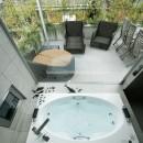 高輪台の家、こだわりの施主と作り上げたバーカウンターのある大型住まいの写真 ジャグジー浴槽