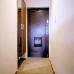 ウッド調のリビングに (玄関)
