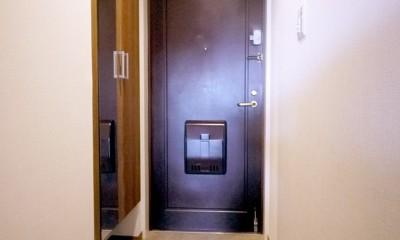 玄関|ウッド調のリビングに