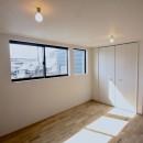 三国の住宅:都心に暮らす家族5人の家の写真 3階主寝室