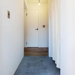 57平米に込めた夫妻の想い (玄関)