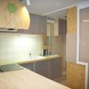 店舗(自然派日用品)付き住宅のリフォームの写真 L字型カウンターは、木製+タイル張り