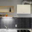 ファッションを楽しむご夫婦のための家の写真 コンパクトなキッチン