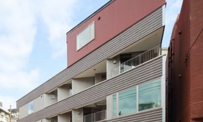 三角形の土地に建つ共同住宅