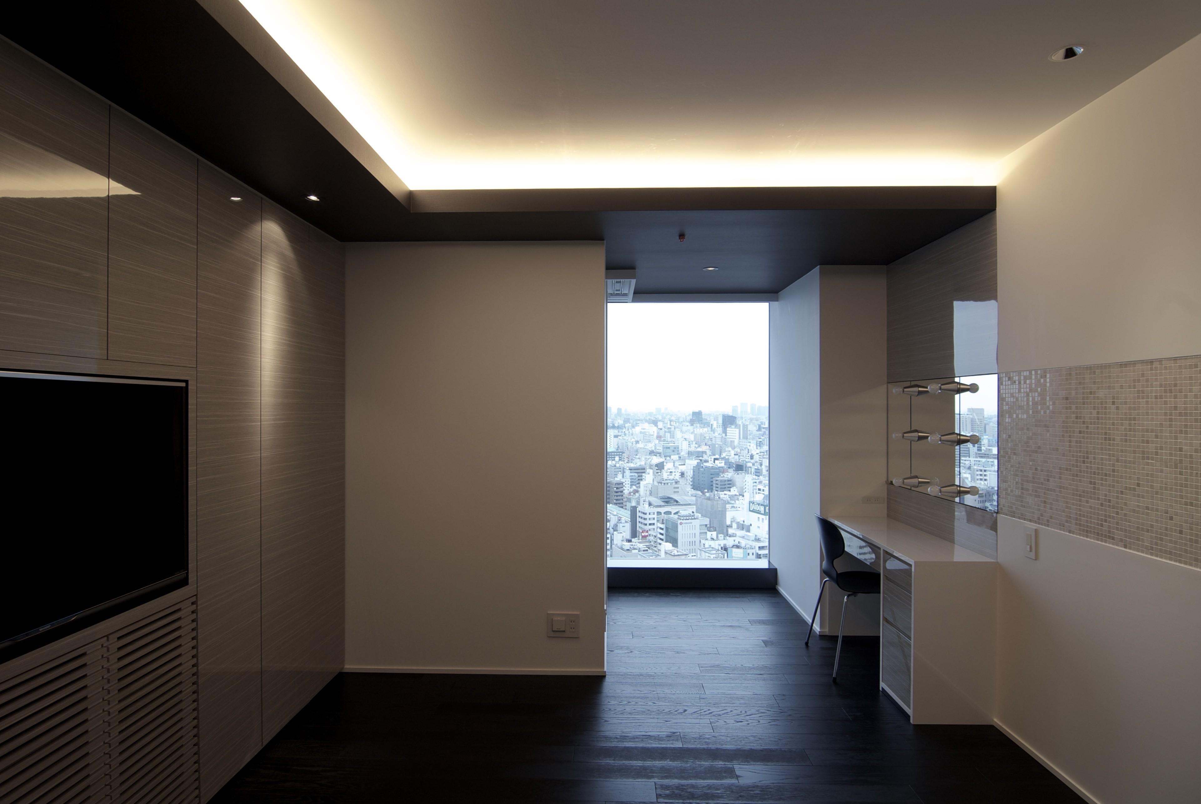 ベッドルーム事例:主寝室(高層階の眺望を楽しむ扇型リビングの家)