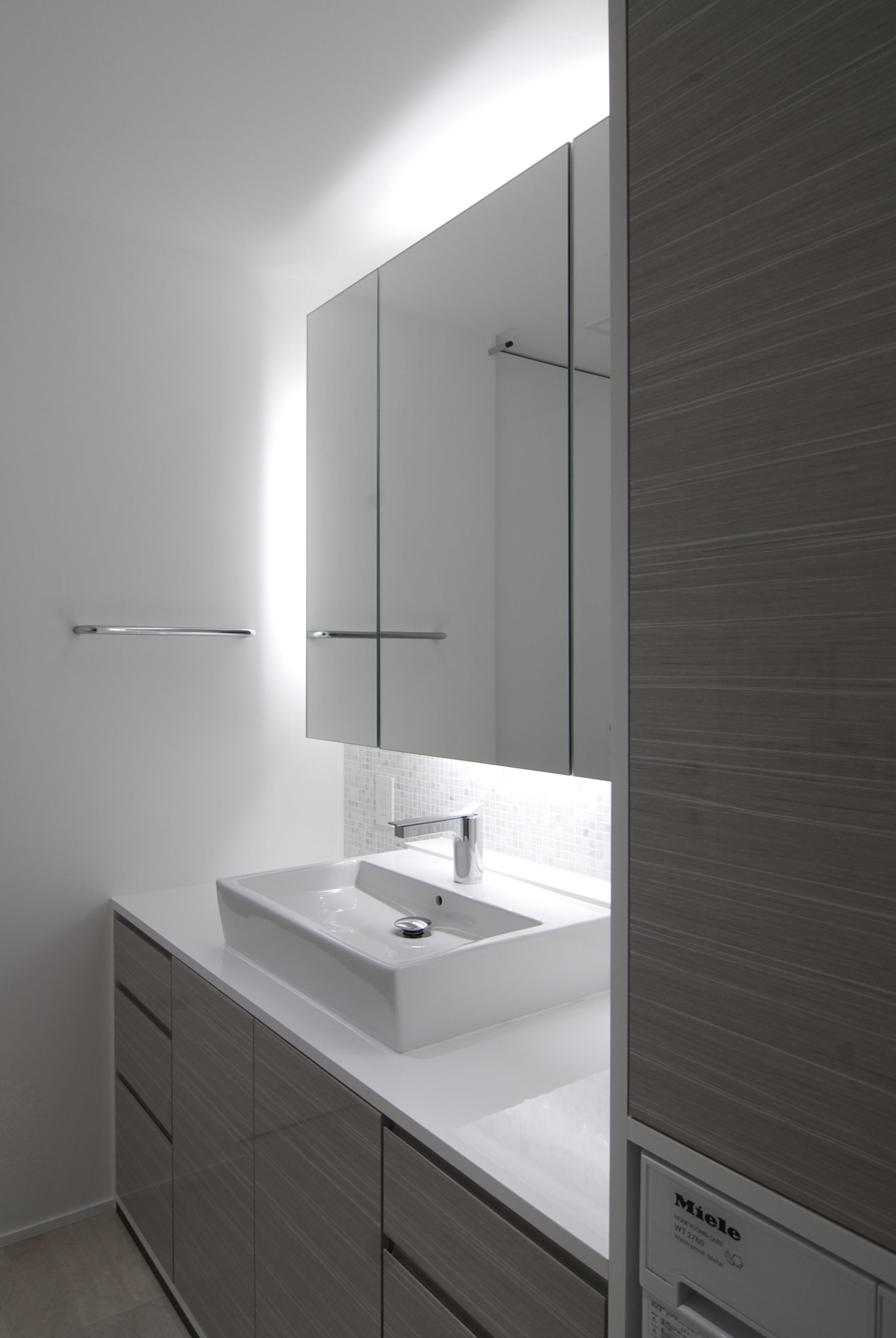バス/トイレ事例:洗面室(高層階の眺望を楽しむ扇型リビングの家)