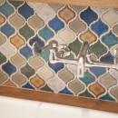 ミニマム空間を広々最大限に生かしたマンションリノベーションの写真 洗面スペースのタイル