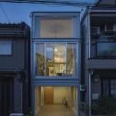 『』の家|鉄骨狭小スキップフロアのガレージハウス【大阪市】の写真 夕景正面
