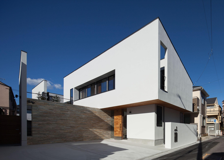 リビングダイニング事例:外観全景(石壁の家 -内外の連続性をつくりだす石壁-)