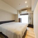 大家族が集まれるダイニングと機能的な収納で生き返るリノベーションの写真 寝室