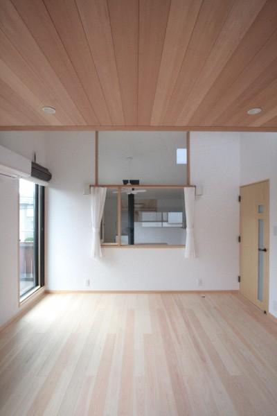 主寝室 (大泉学園の家(薪ストーブを設けた吹抜けを中心とした自然素材の家))