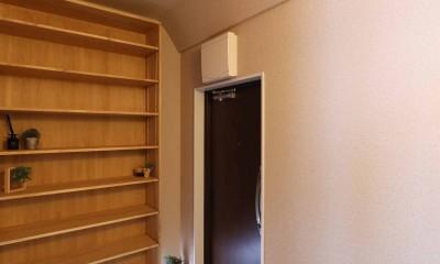 こだわり素材をふんだんに使用した落ち着きのあるリノベーション (玄関)