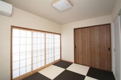 寝室 (玄関で繋がるブロックチェックの二世帯住宅)