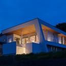 N12-house「回遊テラスのあるガレージハウス」の写真 南東側夕景