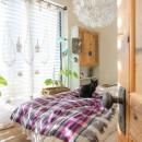 カラフルな異素材ハウスの写真 寝室