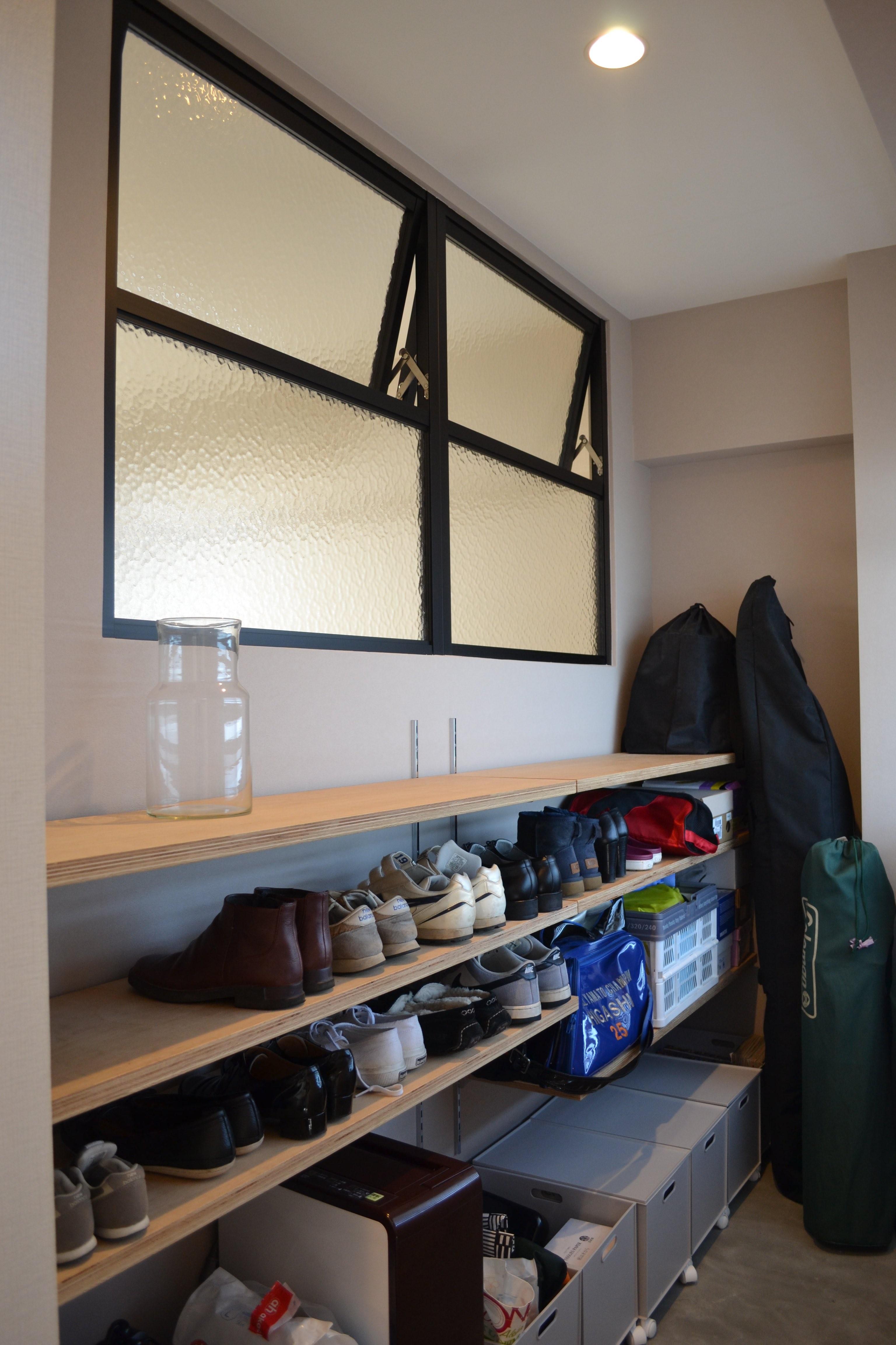 玄関事例:玄関土間スペース(50平米という限られた空間を広く見せるマンションリノベーション)