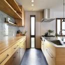新しい家は体にやさしい自然素材の写真 こだわりのタイルが魅力のキッチン