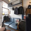 店舗と住居の兼ねた目をひくファサードの家の写真 1階店舗部分