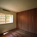 【末広の家 <親の家>】敷地に合わせた末広がりの2世帯住宅の写真 寝室