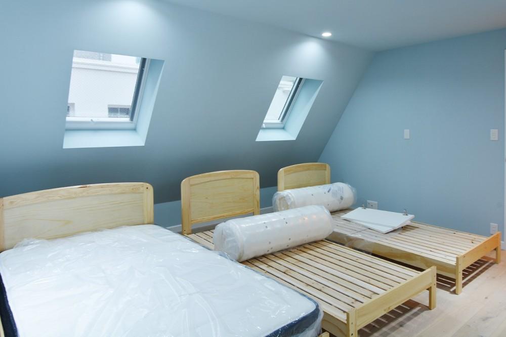 花と過ごす都会の家~賃貸併用二世帯住宅 (子世帯 寝室)
