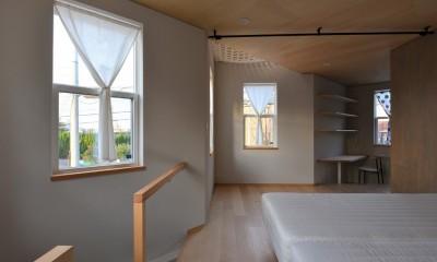 1階主寝室|幾何学模様に出会えるまちの家