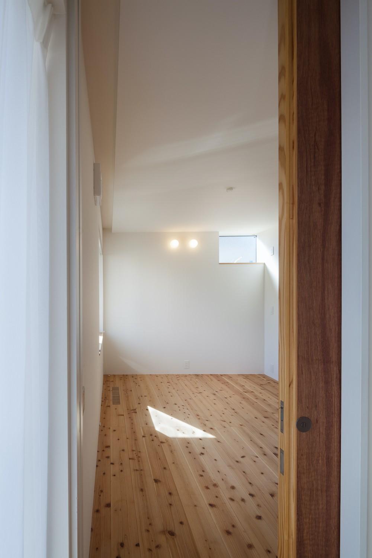 ベッドルーム事例:1階寝室(たまプラーザの家(2世帯住宅))