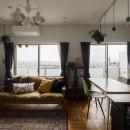A邸-戸建てからマンションへ。サイズダウンしても狭さを感じない部屋の写真 リビングダイニング