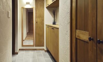 室内干しできるインナーテラスのある住まい (優しくおもてなしする玄関)