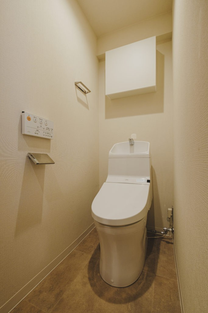 動と静が共存する住まい (トイレ)