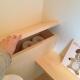 トイレの小さな収納 (カフェのある家)
