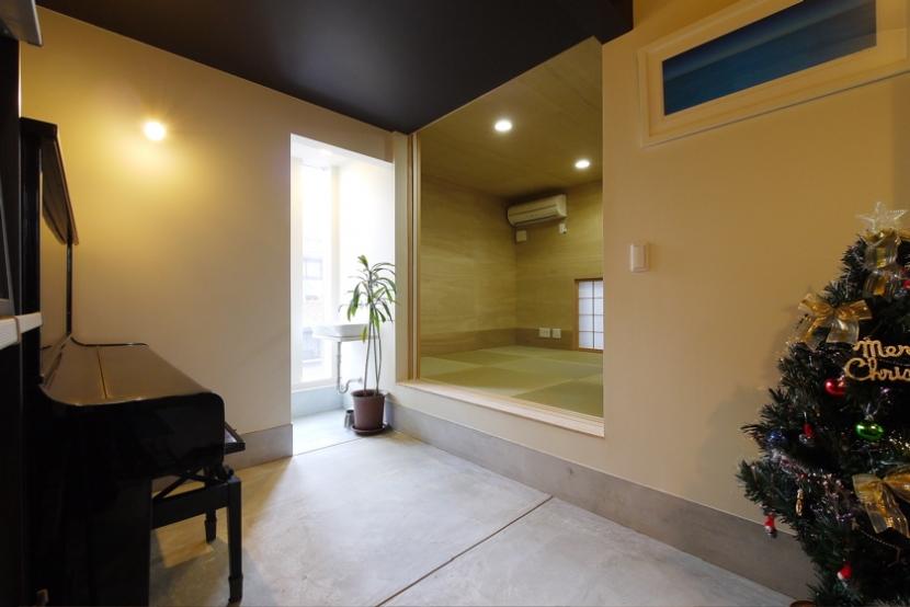 甲南の家:神戸の注文住宅 . ガレージハウス (玄関土間)