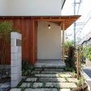 ナツミカンの木と家の写真 玄関ポーチ