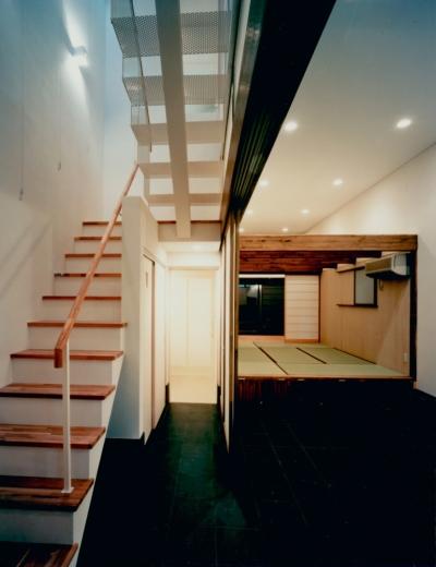 土間 (T House)